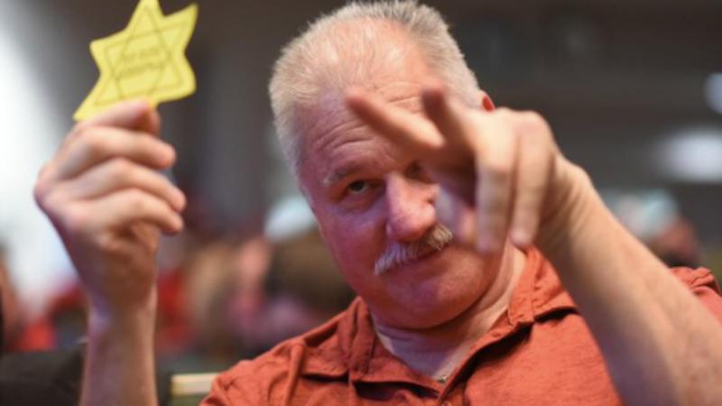 Anti-maskers taunt Jewish assemblyman at chaotic Alaska meeting