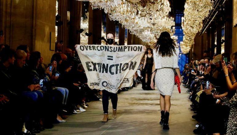Climate change protester crashes Louis Vuitton catwalk show in Paris