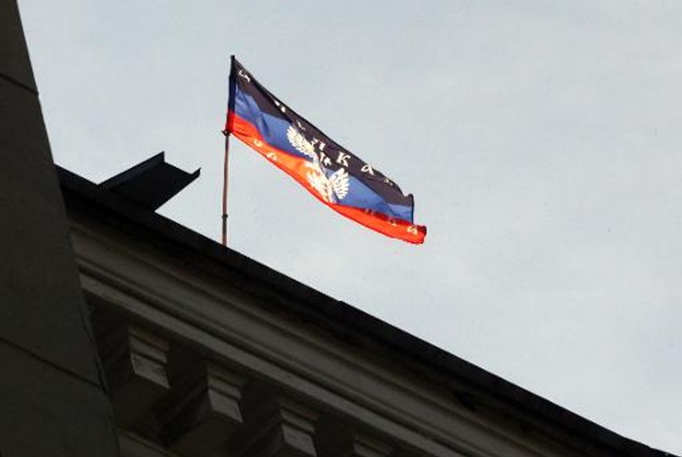 Pro-Russian forces seize control of eastern Ukranian television station