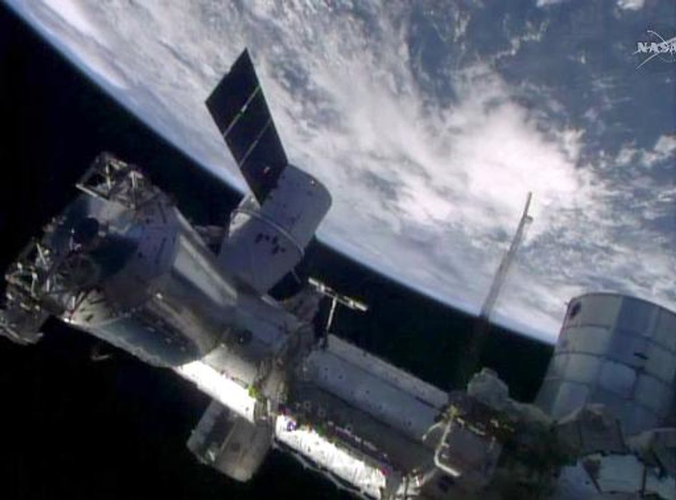 SpaceX's unmanned 'Dragon' supply capsule docks with International Space Station