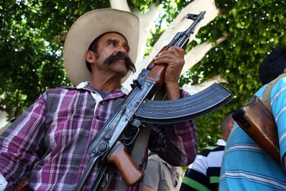 Mexican vigilantes face Saturday deadline to give up guns or join police force