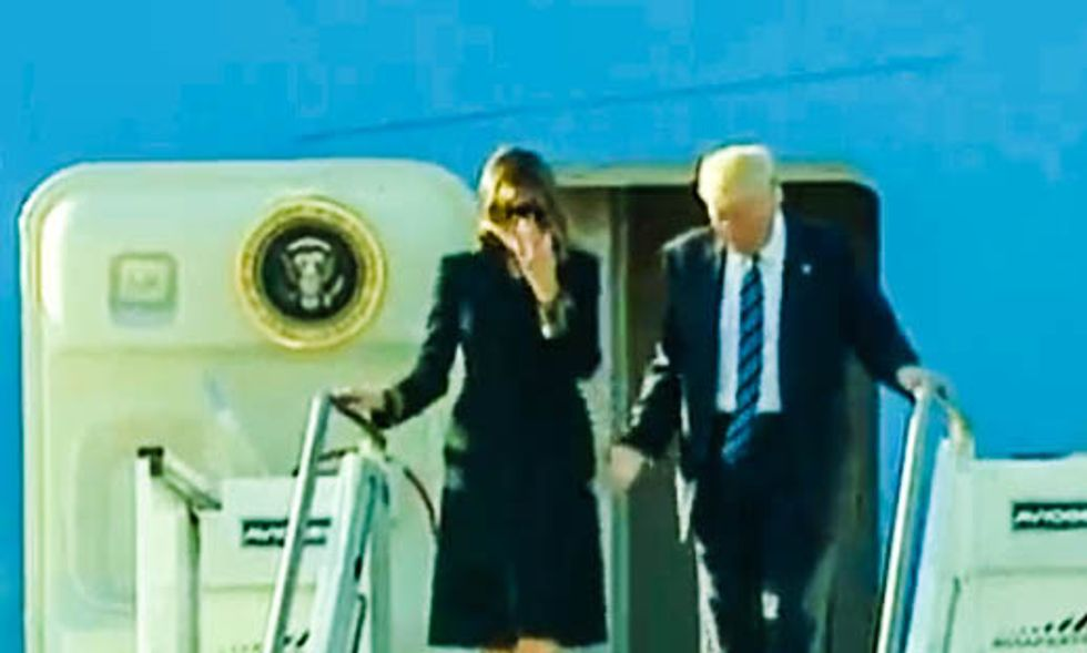 WATCH: Trump again tries to hold Melania's hand in public — and gets denied for second day in a row
