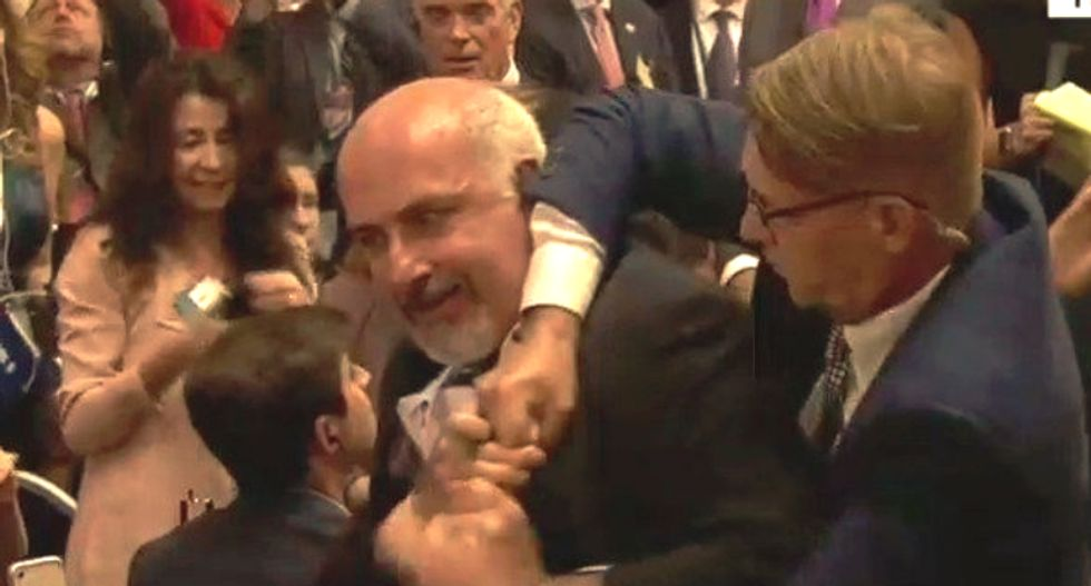 WATCH: Man claiming to be with a progressive news org hauled out of Trump-Putin presser in Helsinki