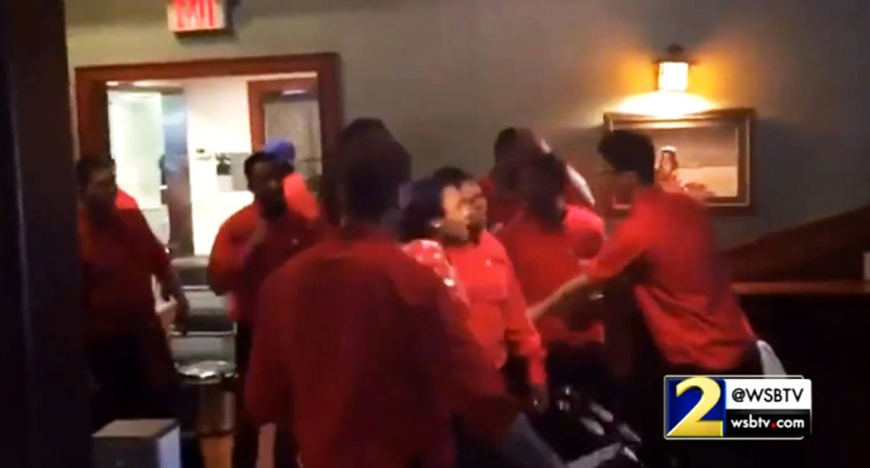 Watch all hell break loose at Georgia steakhouse after customer punches busboy for smiling