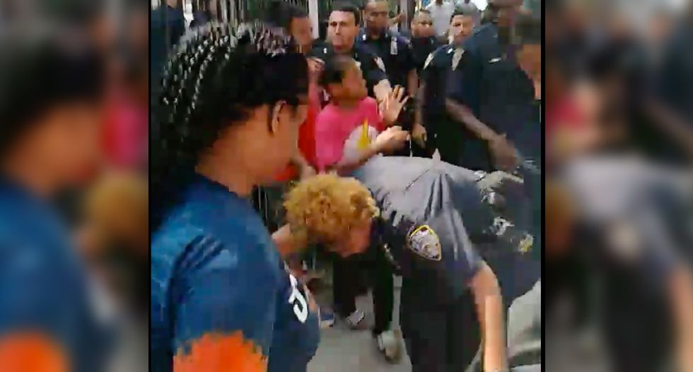 WATCH: Brawl breaks out between neighbors and New York police as officers drag and arrest an unconscious man