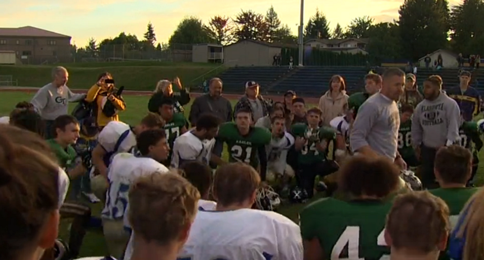 There is 'no freedom from religion': Parents rally behind WA high school coach who leads post-game prayers
