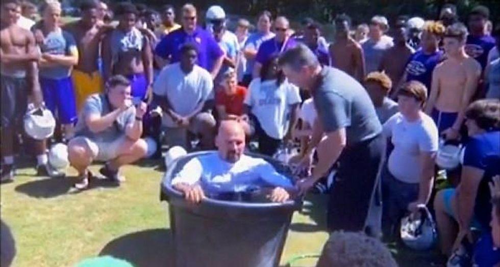Georgia school district repudiates 'bizarre' mass baptisms on football field