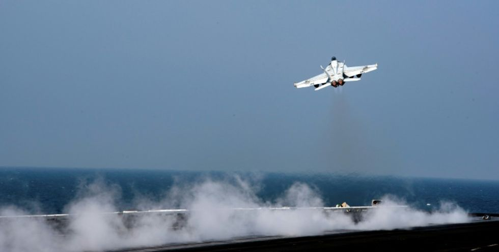 US shoots down Syrian fighter plane in retaliation for attack on coalition forces