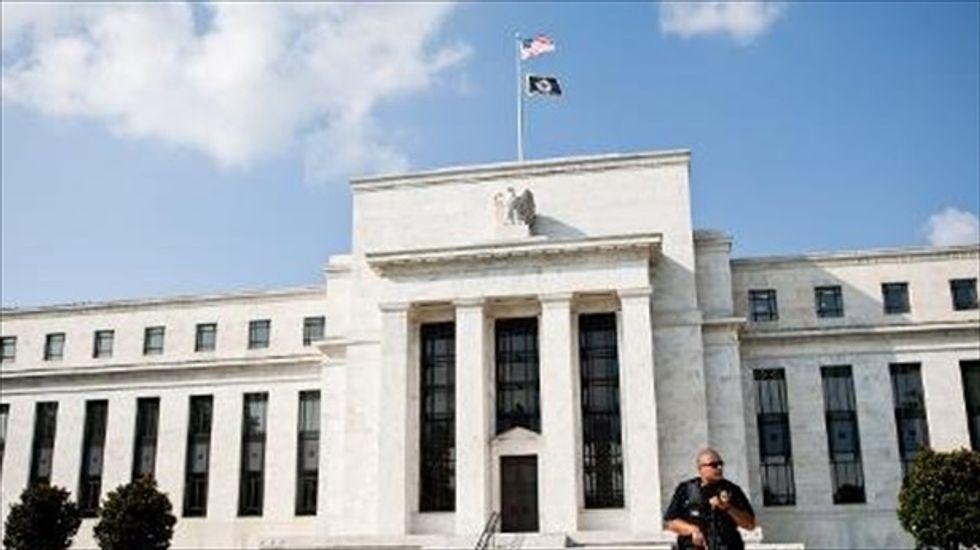 Fed maintains stimulus despite restraints on economic growth