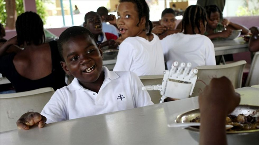 12-year-old orphan's 'robohand' makes him Haiti's first 3-D printer prosthesis recipient