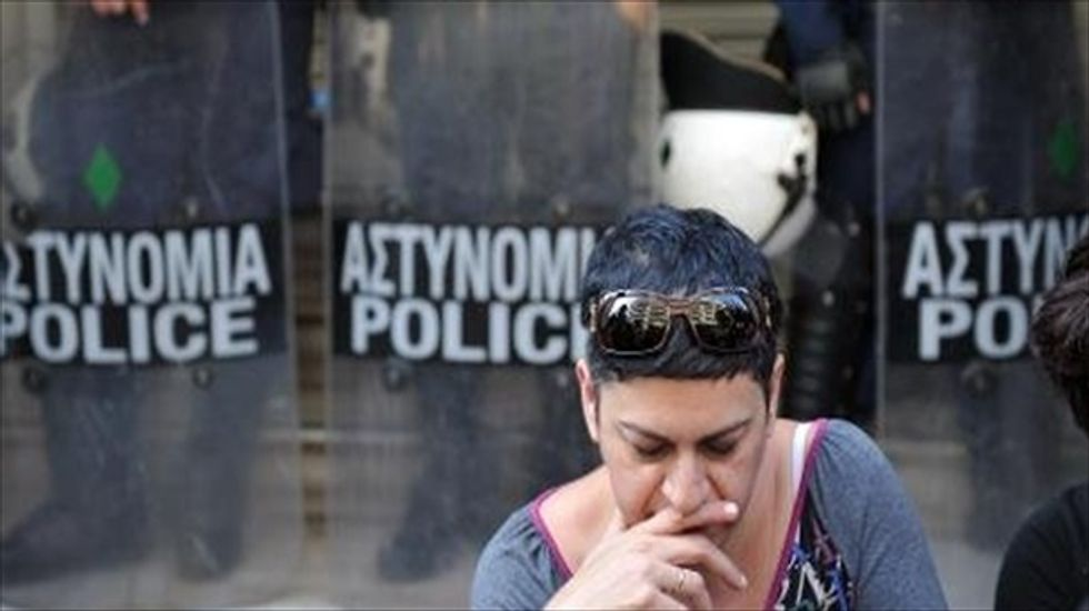 Greek PM vows 'relentless' action after escalating political violence