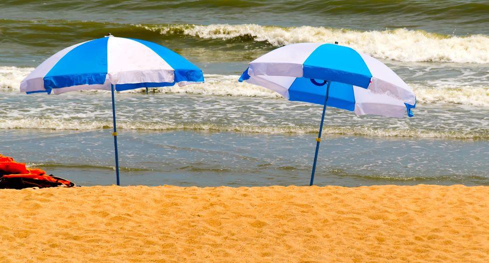 Wind-tossed beach umbrella kills Virginia woman -police