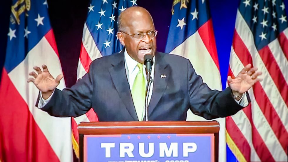 Herman Cain anoints 'shucky ducky' Donald Trump as 'not a racist' at Atlanta rally