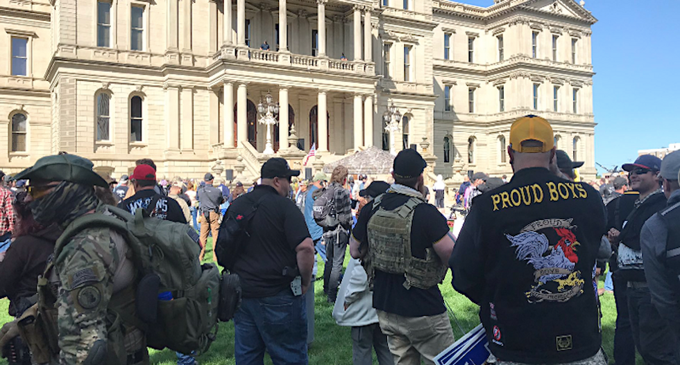 Proud Boys and paramilitary groups join hundreds of armed protesters outside Michigan Capitol