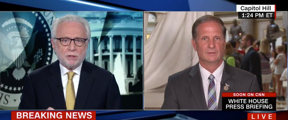 Watch CNN's Wolf Blitzer grill a House Intel Republican for backing Trump's latest weakening of NATO