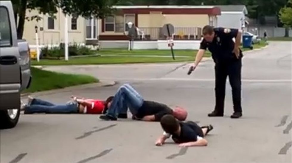Ohio cop caught waving Tazer at handcuffed family