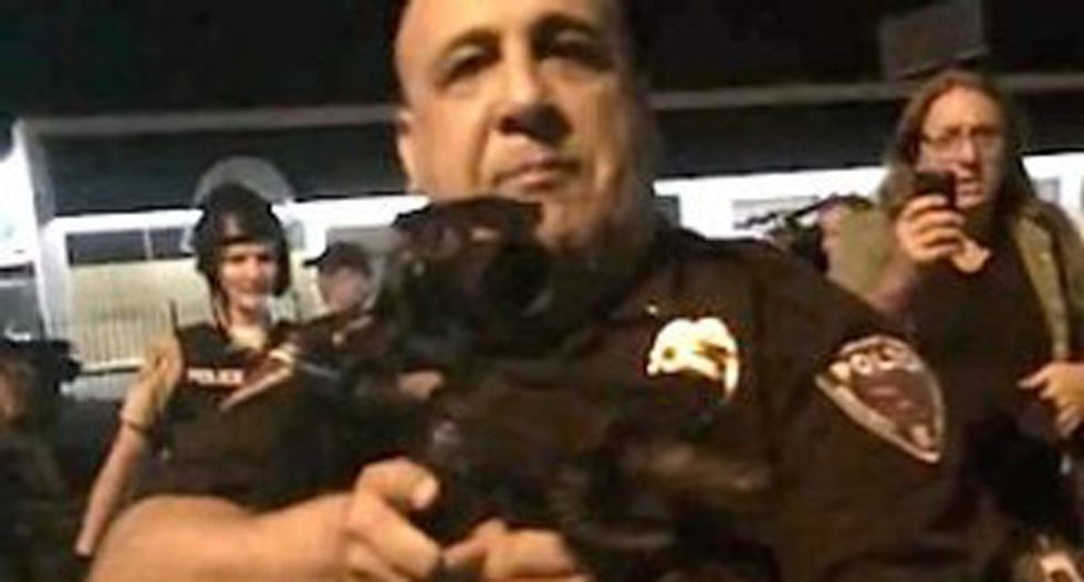 Ferguson cop says life is 'ruined' after pointing AR-15 at journalists and saying, 'I'm going to f*cking kill you!'