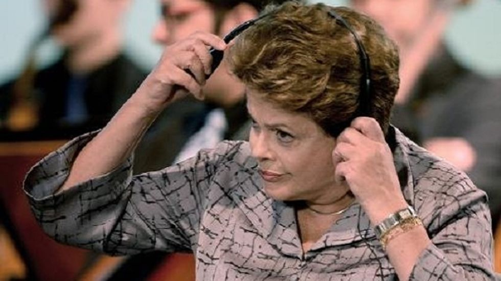 Exit poll: Incumbent Rousseff to face Neves in runoff for Brazilian presidency