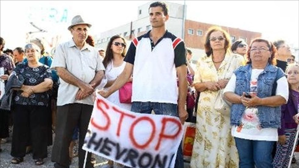 Romanian villagers and priests occupy Chevron fracking site in protest
