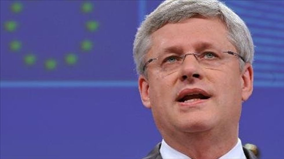 Canadian PM Harper rejects accusations linking him to bribery scandal