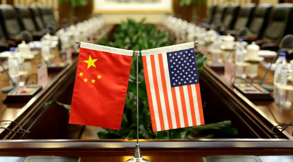 China says US putting 'knife to its neck', hard to proceed on trade