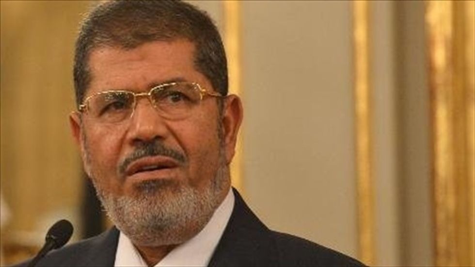 Morsi rejects Egyptian court's authority to try him on incitement charges