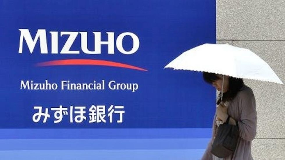 Japan to probe megabanks after mobster loan scandal