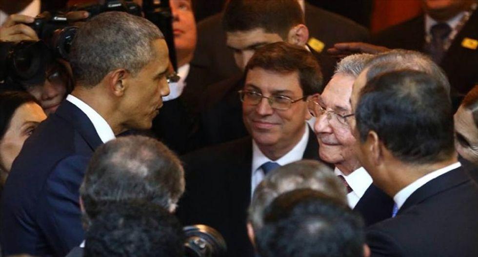 Historic handshake: Obama and Raul Castro meet during Panama summit