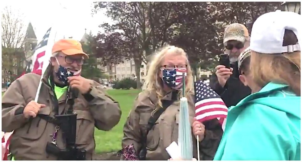 'You callin' me an idiot?' Protesters caught on video bickering over bringing guns to Michigan anti-lockdown protest