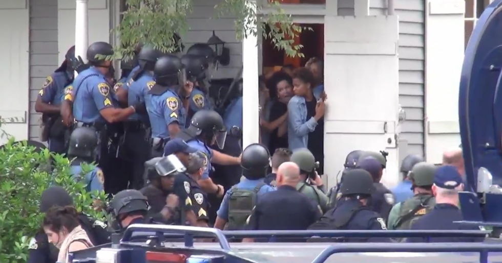 Baton Rouge cops barge into woman's yard to arrest Black Lives Matter protesters she invited