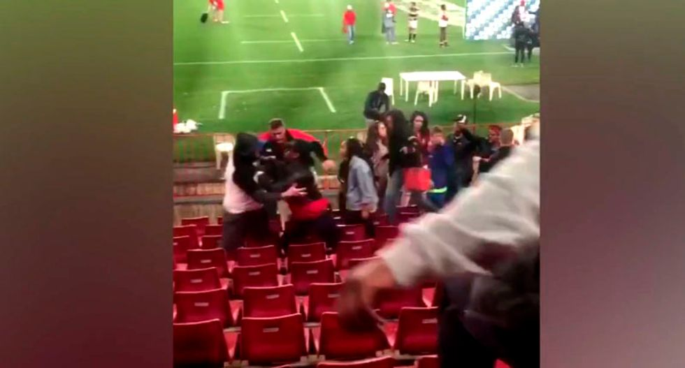 WATCH: Racist brawl erupts in stadium after black woman rejects white man's advances