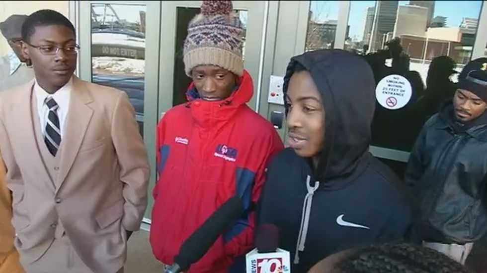 Three black students waiting for bus arrested after cops order them to 'disperse'