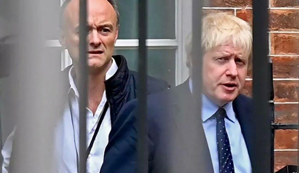 Boris Johnson defiant as political scandal rages over aide