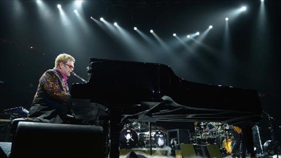 Elton John keeps promise to call out Russia's anti-LGBT laws