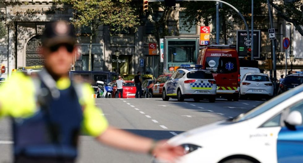At least 13 dead and more than 50 injured as van rams crowd in Barcelona 'terror attack'