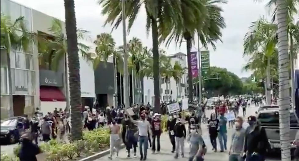 WATCH: Protesters chant 'Eat the Rich' while marching down Rodeo Drive in Beverly Hills