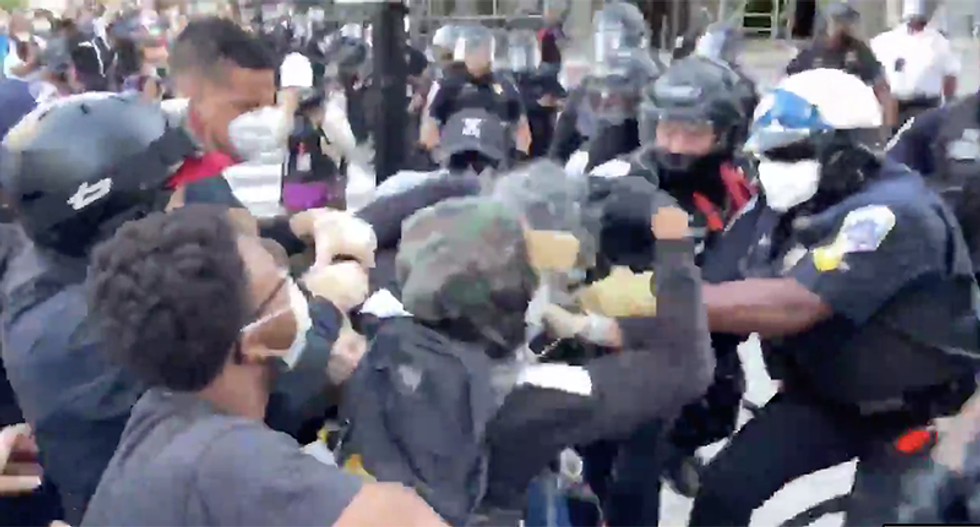 WATCH: DC protesters turn over 'agitator' to police -- then the agitators try to start a fight with cops
