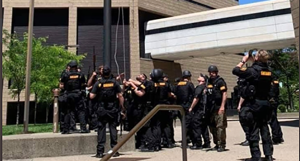 Cincinnati sheriff deputies replace American flag at the Justice Center with 'thin-blue-line' flag