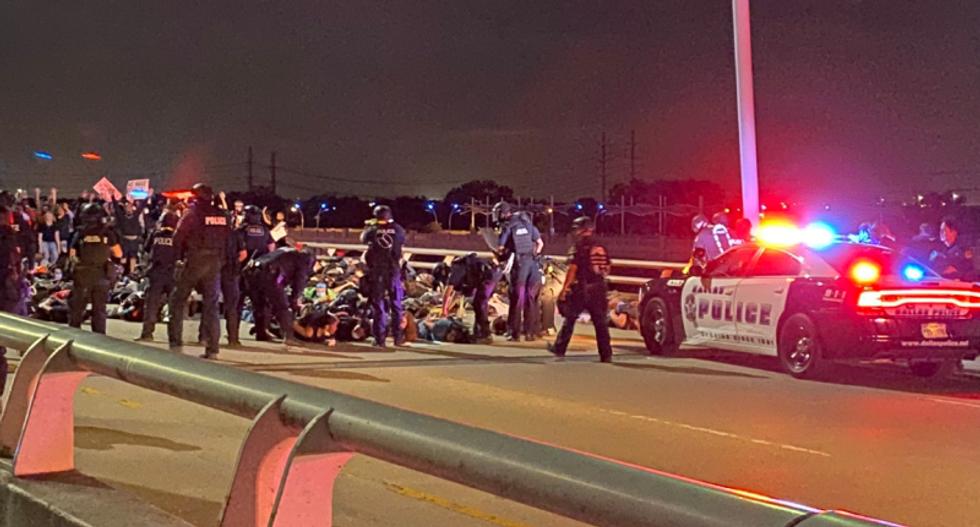 Texas police trap protesters marching across Dallas bridge
