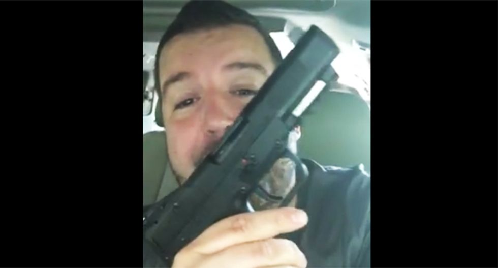Gun-packing pastor threatens to pump anyone who threatens cops with '20 rounds of pure brutality'
