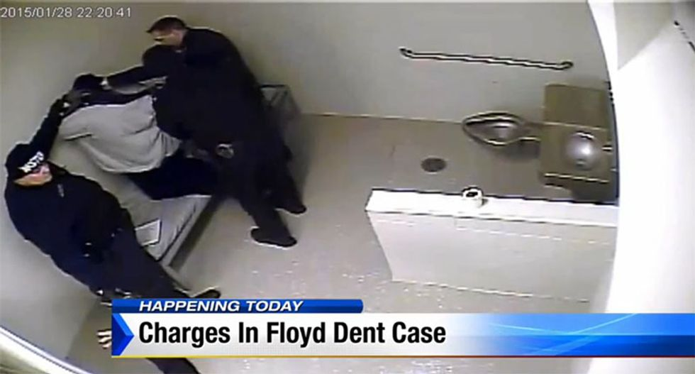 Detroit 'RoboCop' officer charged after videos show brutal beating of drug suspect
