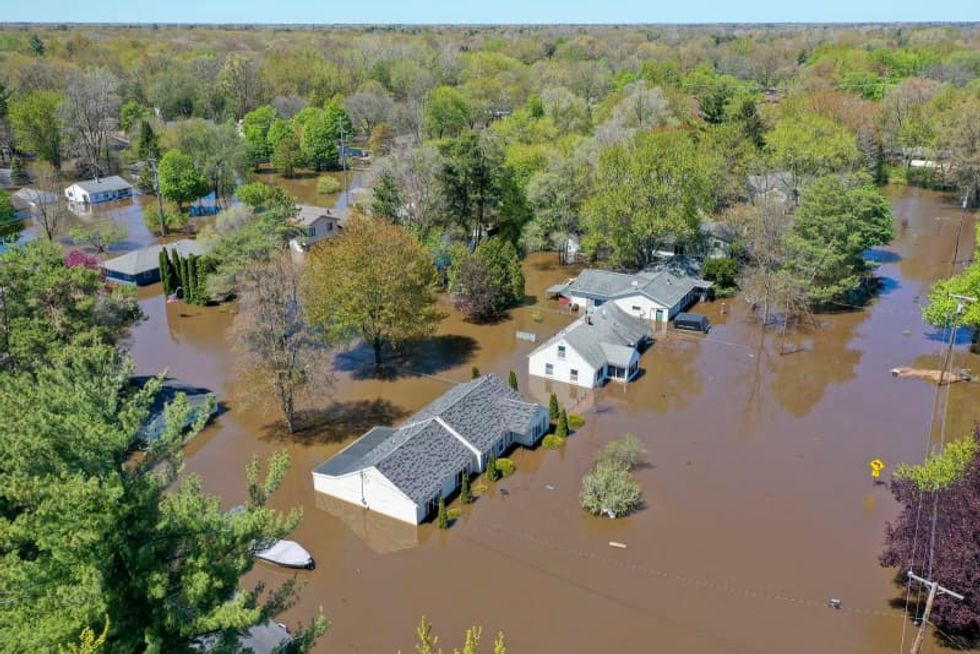 Michigan officials sue dam owners for flood damage, repairs