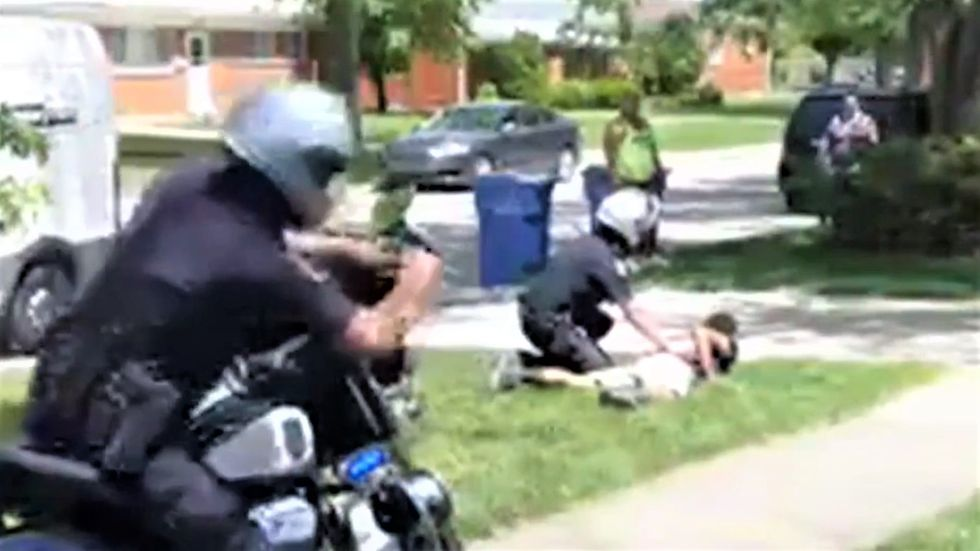 WATCH: Neighbors stunned as cop takes down Black Amazon driver for parking the wrong way