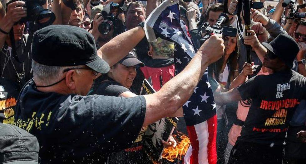 Cleveland cops arrest 17 protesters after flag-burning display outside RNC