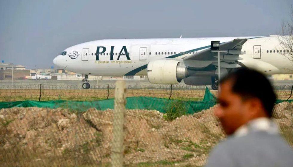 Passenger plane with more than 100 on board crashes near Karachi, Pakistani authorities say