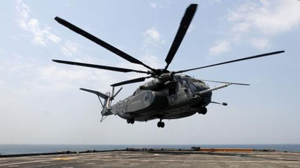 Rescue teams search for crew members of Navy helicopter that crashed off coast of Virginia