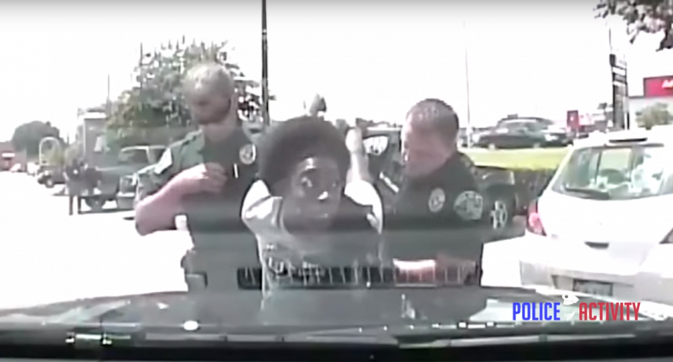 WATCH: Austin cops body slam black teacher and tell her whites are right to fear 'violent' blacks