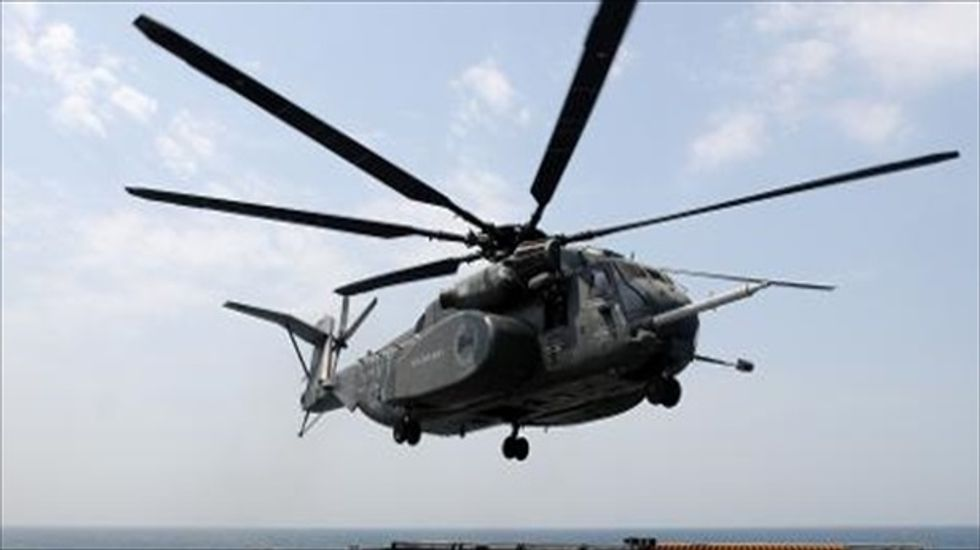 Two people dead and one missing after Navy helicopter crash