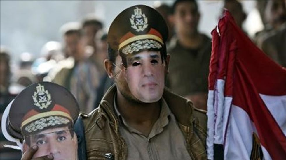 Egypt government resigns, paving way for Sisi to seek presidency