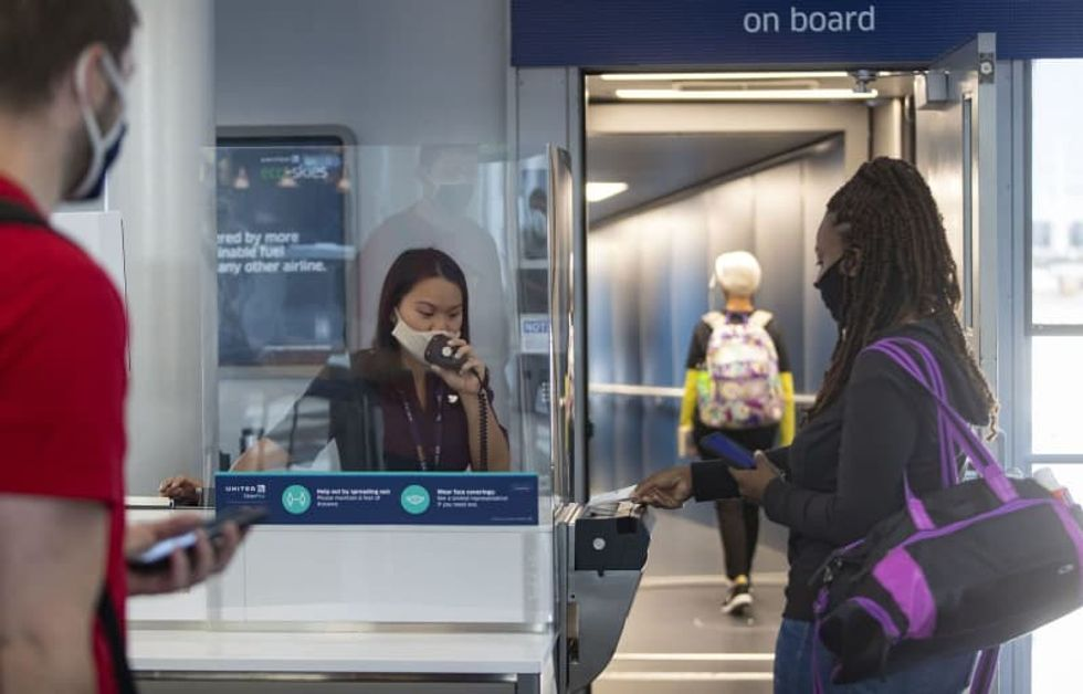 Summer air travel: Masks, a new boarding routine and bagged snacks